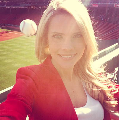 Reporter almost hit by baseball at Fenway Park while taking photo.