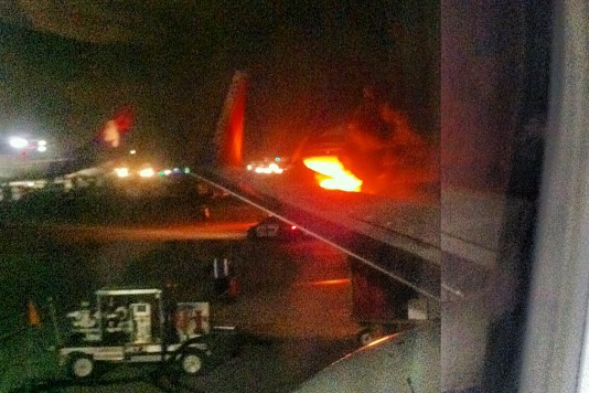 Plane on fire at LAX